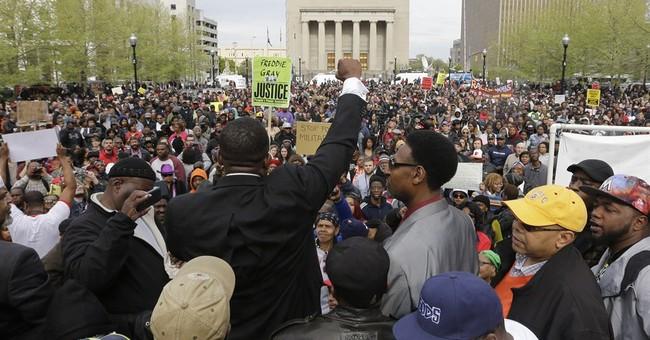 A dozen arrested as Freddie Gray protests turn violent