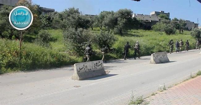 Syrian insurgents capture military base in northwest