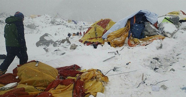 Avalanche sweeps Everest base camp, killing 17, injuring 61