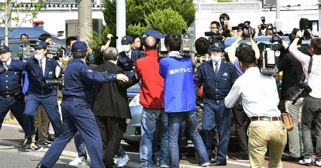 Police arrest man over drone landing at Japan PM office