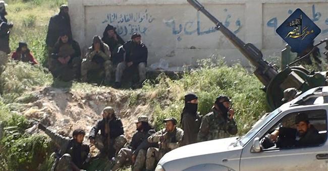 Activists: Syrian air raids kill 34 in northwestern town