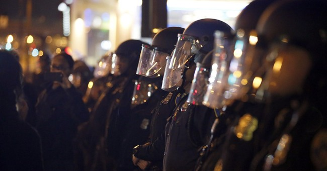 Photographer says Baltimore police beat him during protest