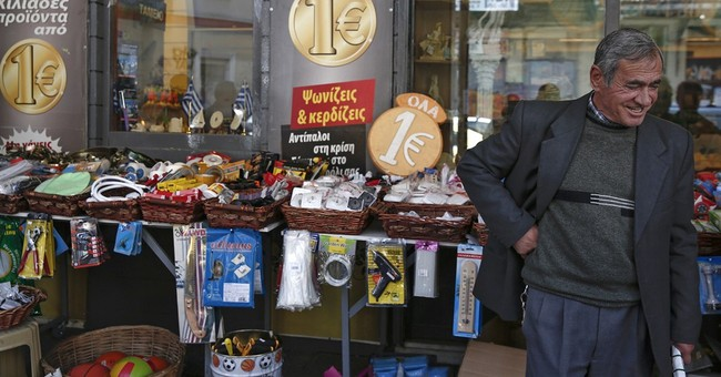 Greek PM says initial deal in bailout talks 'very close'