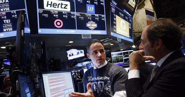 Asian markets tepid ahead of major earnings, Fed meeting