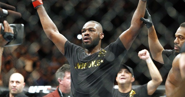 UFC champ Jones booked in connection with hit-and-run crash