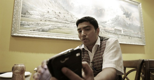 Expats try phones, social apps to connect to quake-hit Nepal