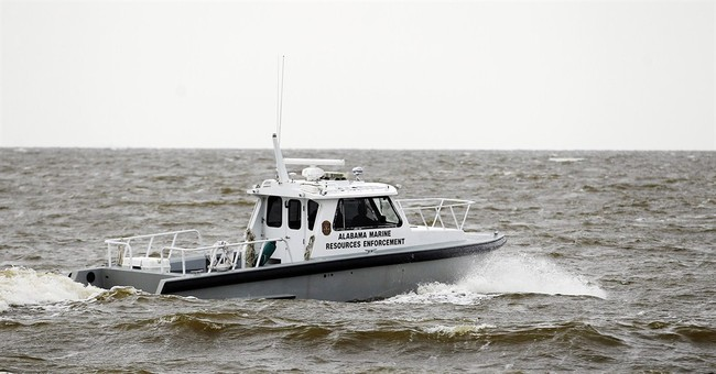 Wife: Sailor died trying to save others; 3 boaters missing