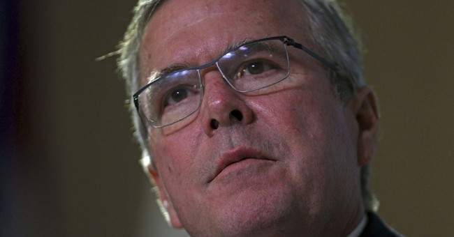 Bilingual Bush talks immigration in Puerto Rico