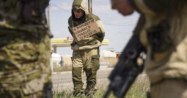 Ukraine's rebels mete out rough justice in authority vacuum