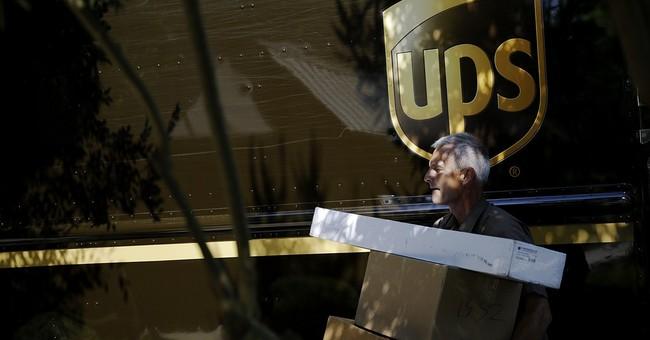 UPS 1Q profit up 14 percent to more than $1 billion