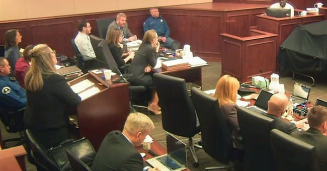 The Latest: Theater trial adjourns after emotional 911 call