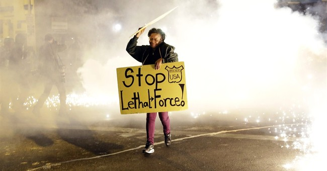 Police clash with Baltimore protesters for a second night