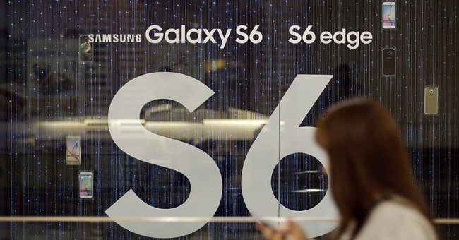Samsung's profit hit by bigger iPhones, sinks 39 percent