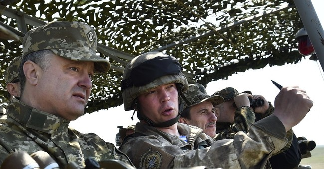 Ukraine says rebels firing rocket launchers again