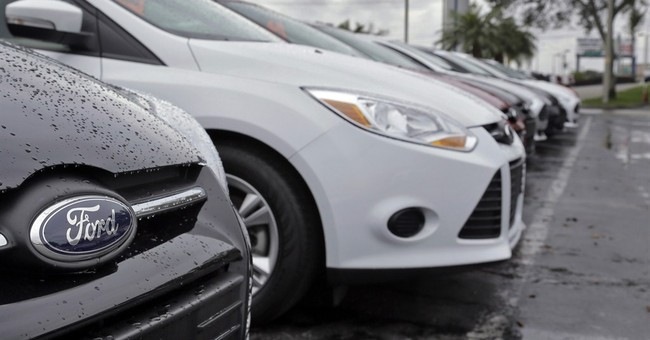 Ford's 1Q net income falls on strong dollar, lower sales