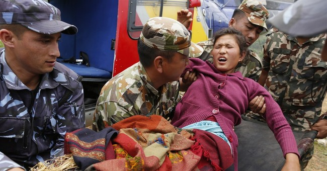 The Latest on Nepal: Under rubble, man says he drank urine