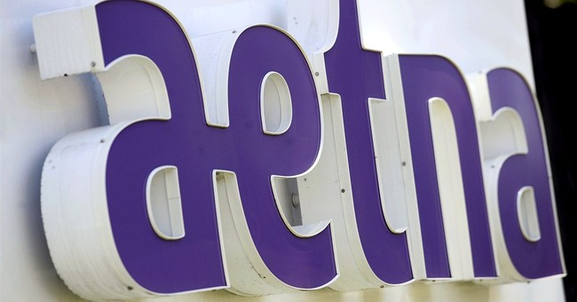 Aetna raises 2015 outlook after 1Q earnings tops forecasts