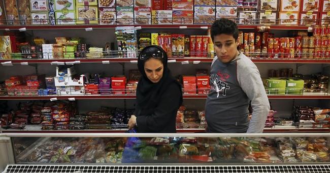 Iran scraps cash handouts to its wealthiest to ease burden