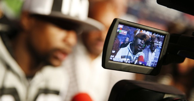 Big price, big expectations for Mayweather-Pacquiao pay TV