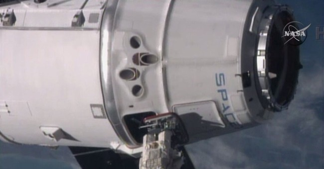 SpaceX supply ship arrives at space station with groceries