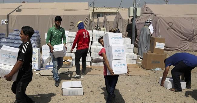 Car bombs kill 21 people in Iraq; EU warns of donor fatigue
