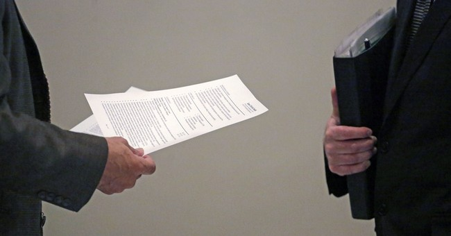 Applications for US unemployment aid plunge to 15-year low