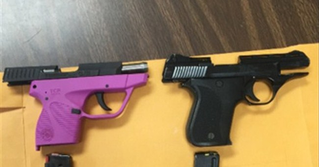 Officials: 2 elementary school pupils took guns to school