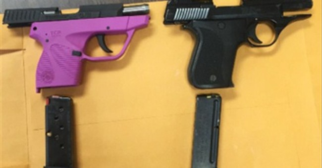 Officials: 2 elementary school pupils took guns to school