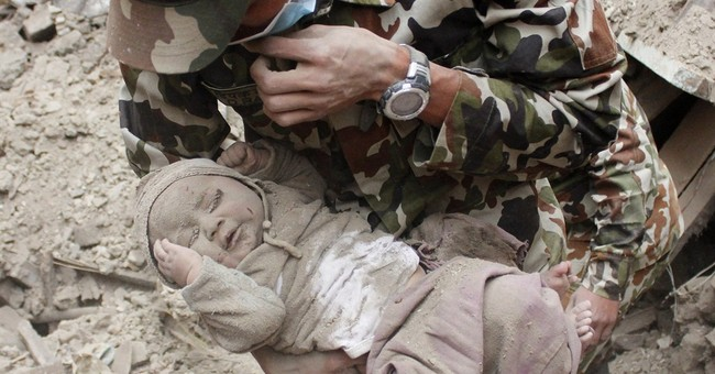 His sorrow left when Nepalese photographer saw baby's rescue
