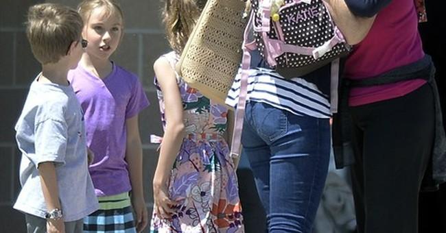 Girl, 14, stabbed at suburban Denver school; boy detained