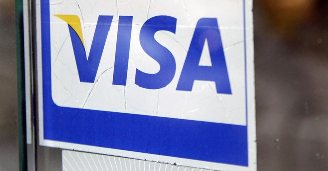 Visa 2Q profits fall 3 percent on strong dollar, gas sales