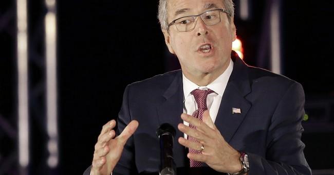 As Bush touts fundraising haul, Clinton lowers expectations