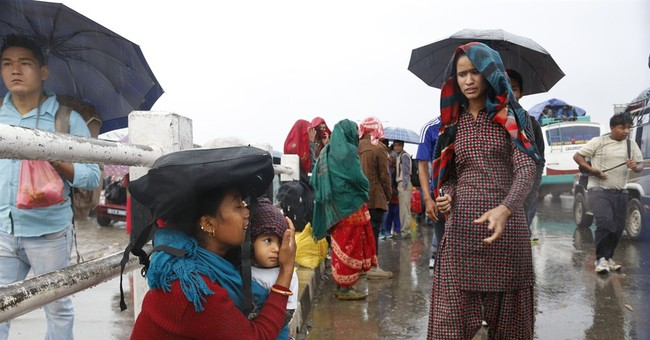 The Latest on Nepal: $1,000 for each family of those killed