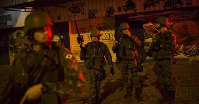Pacifying police move into violent Rio slum, replacing army