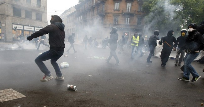 Milan Expo protesters torch parked cars, smash windows