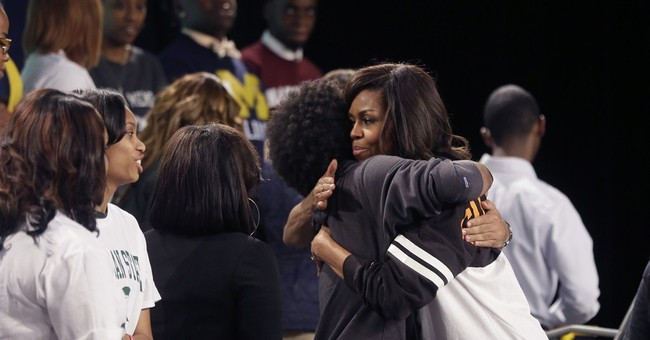First lady touts academics in Detroit college signing speech