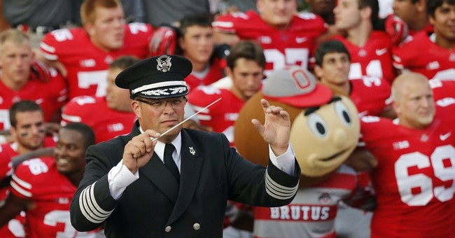 Judge: Ex-Ohio St band director has 4 months to prove claims
