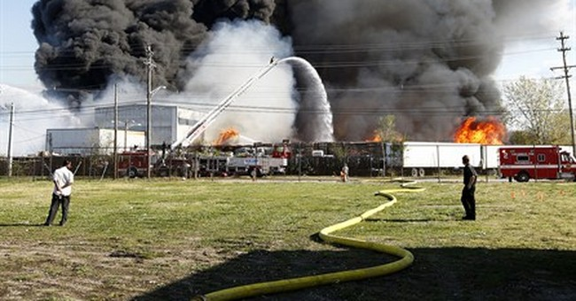 Fire official says smoke from warehouse fire likely toxic