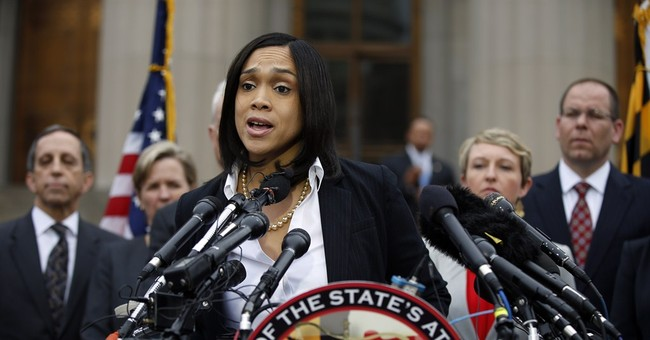 The Latest: Baltimore lifts curfew after days of tension