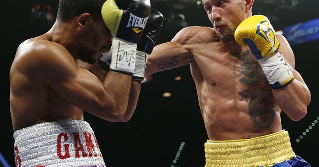 The Latest: Mayweather's dad says fighter done after 1 more