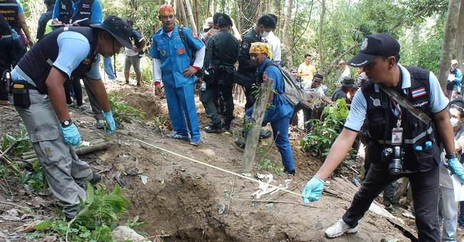 Thai police dig up 26 bodies at suspected trafficking camp