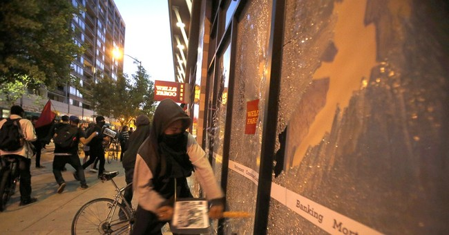 After calm protests in Oakland, smaller group turns violent