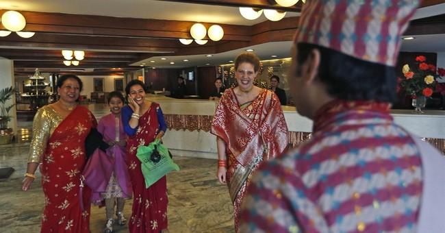 AP PHOTOS: Kathmandu wedding shows life goes on in Nepal