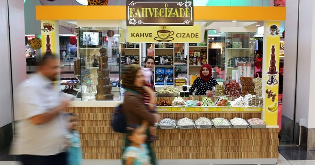 In Iraqi malls, Syrian women work jobs spurned by locals