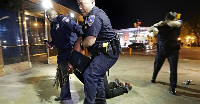 The Latest:  Arrested protester: Curfew law very egregious