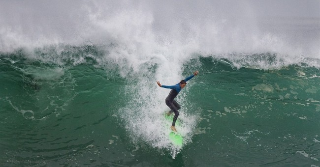Huge waves in California lure bodysurfers, crowds to beaches