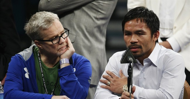 Suit filed against Pacquiao for not disclosing injury