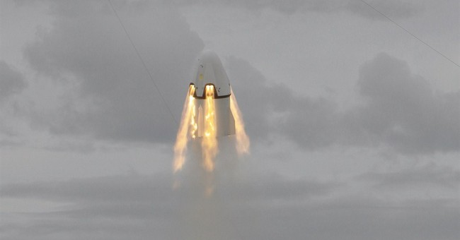 SpaceX capsule soars with dummy in 1st test of crew escape
