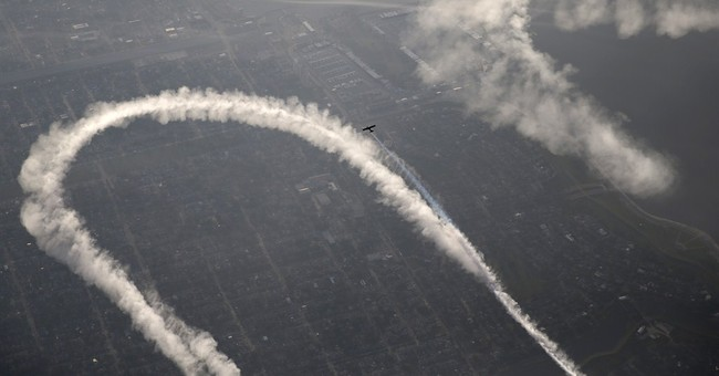PHOTOS: Skywriter's message of love, peace and smiley faces