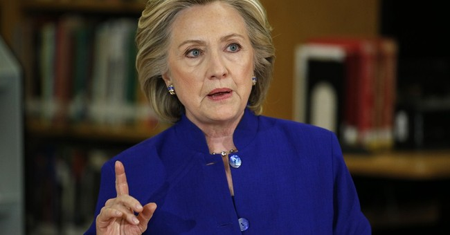 Clinton pushes immigration overhaul to campaign forefront